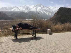 Random Chinese man sleeping on a bench. See, they sleep anywhere.