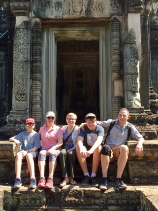 Sitting on the ancient steps of Banteay Samre