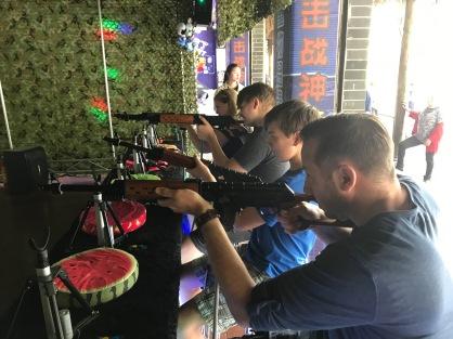 Having fun playing an arcade game